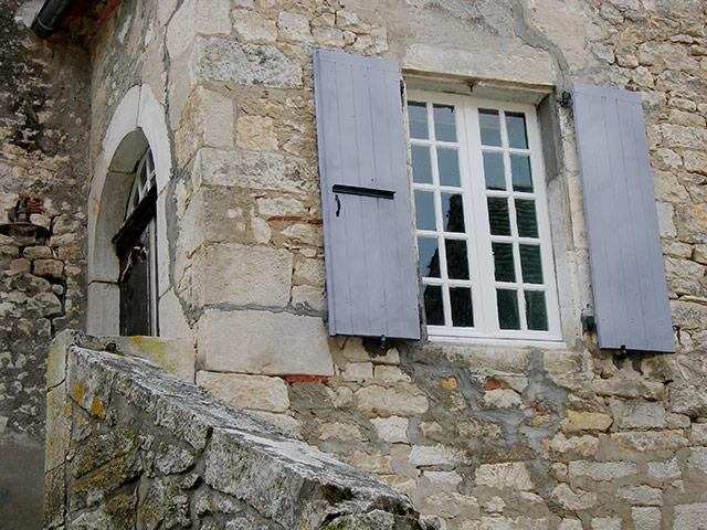 Gray Shutters In A Village, On A Randonee
